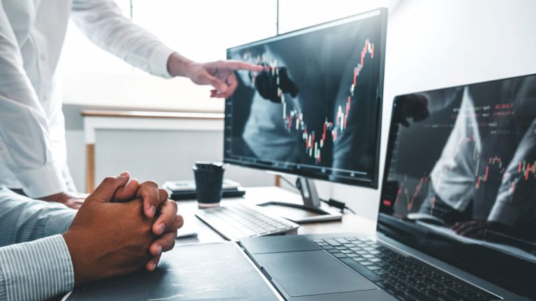 Men Viewing stock market trends Buy Low and Sell High